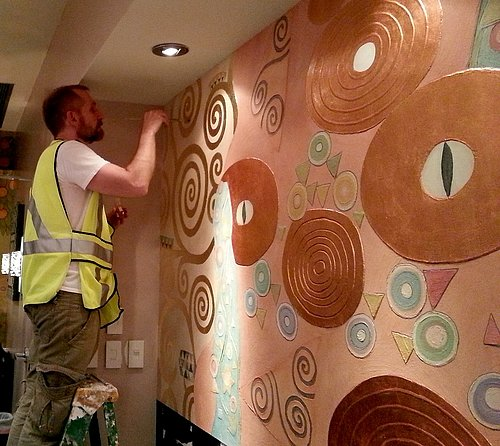 Jeff Huckaby and the mural he painted for a shop at the Downtown Disney shopping complex near Orlando.