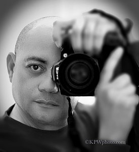Photographer Ken Williams holding Nikon Camera