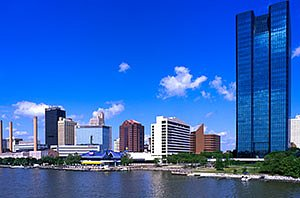 Toledo Ohio downtown buildings in summer with blue sky and the Maumee river. Horizontal photo by Ohio Stock Photography 12U103