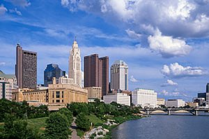 Columbus Ohio Skyline in summer with blue sky, dramatic clouds, and the Scioto River. Horizontal  photo by Ohio Stock Photography 1L1636
