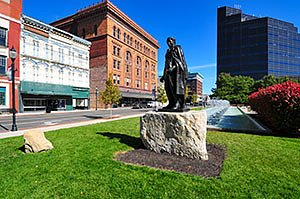 Springfield Ohio downtown buildings in summer, with statue, fountain, and red bush. Horizontal photo by Ohio Stock Photography D71U-7
