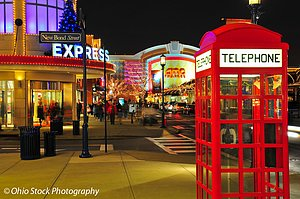 Night view of red telephone booth and stores lit up with lights at Easton Town Center in Columbus Ohio photo by Ohio Stock Photography D65L162