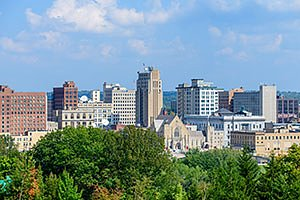Youngstown Ohio Skyline in summer with blue sky and green trees. Horizontal photo by Ohio Stock Photography FX39U-176