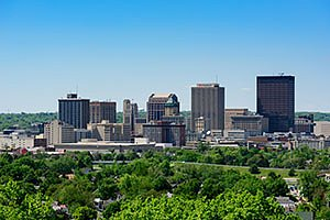 Dayton Ohio Skyline in summer with blue sky and green trees. Horizontal photo by Ohio Stock Photography FX4U954