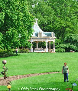 Lady standing on lawn in front of gazebo near sculptures at Fellows Riverside Gardens photo by Ohio Stock Photography D14M2