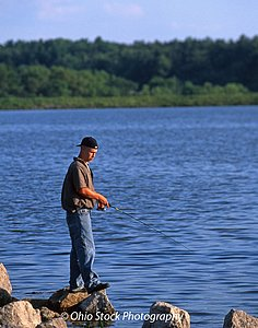 Fisherman standing on a rock at Guilford Lake State Park photo by Ohio Stock Photography