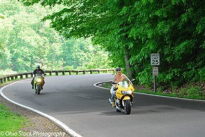 Two motorcycles on road lined with trees at Mill Creek Park photo by Ohio Stock Photography D33A3