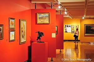 Art gallery with paintings on red and yellow walls and statue of horse and rider at the Butler Institute of American Art photo by Ohio Stock Photography D32V55