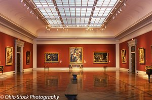 Art gallery at the Toledo Museum of Art with red walls, a skylight, and a bench in the center photo by Ohio Stock Photography 13V48.