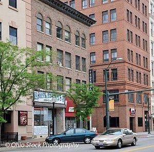 City scene of buildings in downtown Youngstown with two cars on road photo by Ohio Stock Photography D39U58